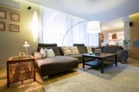 Hoe richt u uw  woonkamer in met een hoekbank?